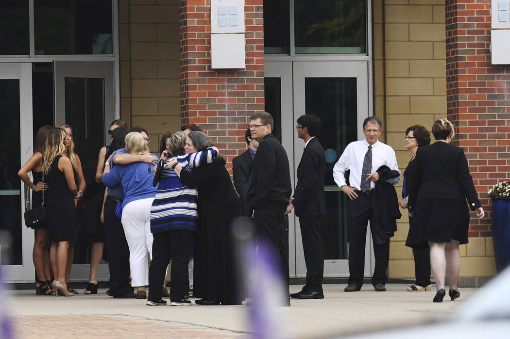 Mourners arrive for the funeral of Otto Warmbier, Thursday, June 22, 2017, in Wyoming, Ohio. Warmbier, a 22-year-old University of Virginia student who was sentenced in March 2016 to 15 years in p ...