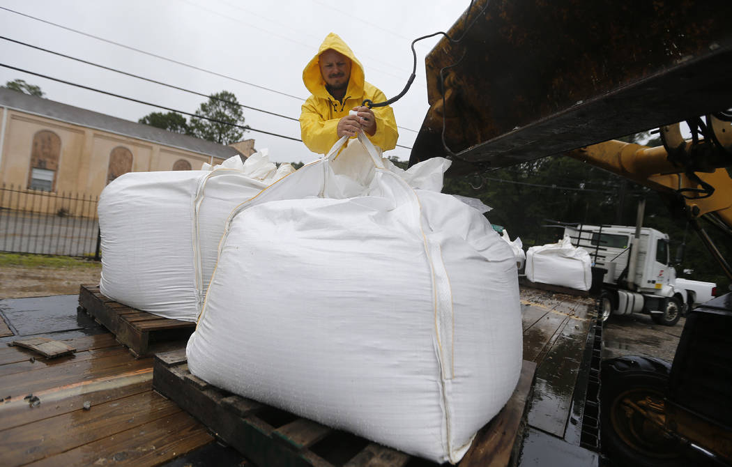 Volunteers put out sand bags due to the arrival of Tropical Storm Cindy in Lafitte, La., Wednesday, June 21, 2017. Tropical Storm Cindy sent drenching rain bands over the north Gulf Coast on Wedne ...