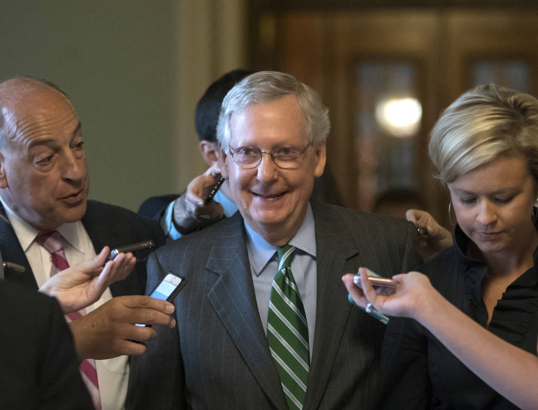 Senate Majority leader Mitch McConnell smiles as he leaves the chamber after announcing the release of the Republicans' healthcare bill which represents the party's long-awaited attempt to scuttle ...