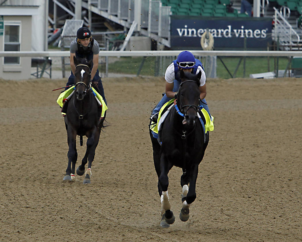 Kentucky Derby 143 hopefuls Untrapped, right, ridden by exercise rider Juan Vargas, and McCracken, left, ridden by Yoni Orantes, turn into the backstretch during a morning work out at Churchill Do ...