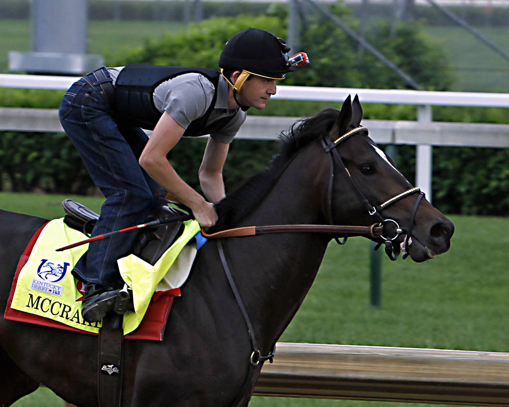 Exercise rider Yoni Orantes guides Kentucky Derby 143 hopeful McCracken through a work out at Churchill Downs in Louisville, Ky., Sunday, Apr. 30, 2017. (AP Photo/Garry Jones)