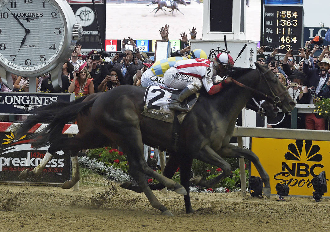 Cloud Computing (2), ridden by Javier Castellano, wins the 142nd Preakness Stakes horse race ahead of Classic Empire, ridden by Julien Leparoux, Saturday, May 20, 2017, at Pimlico Race Course in B ...
