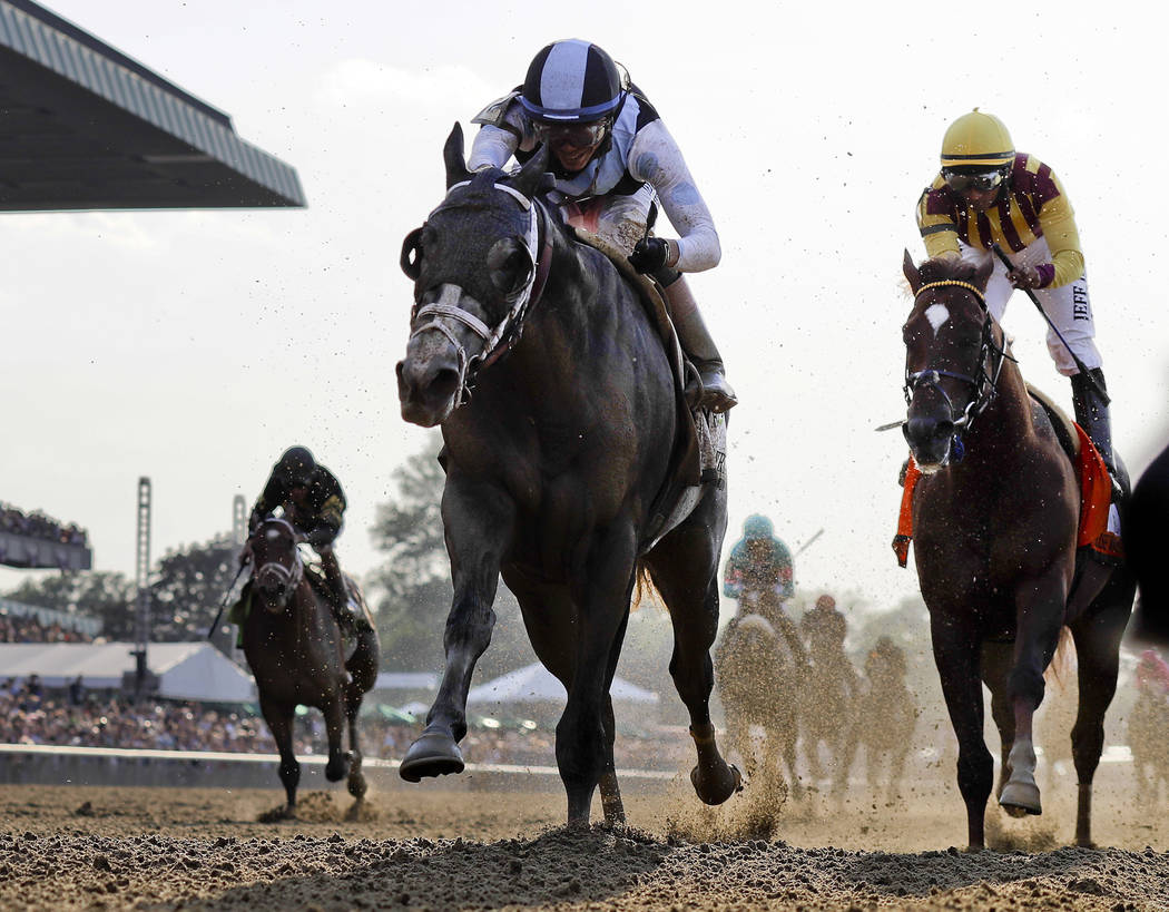 Tapwrit, left, ridden by Jose Ortiz, wins the 149th running of the Belmont Stakes horse race, Saturday, June 10, 2017, in Elmont, N.Y. Irish War Cry, ridden by Rajiv Maragh, right, finished second ...