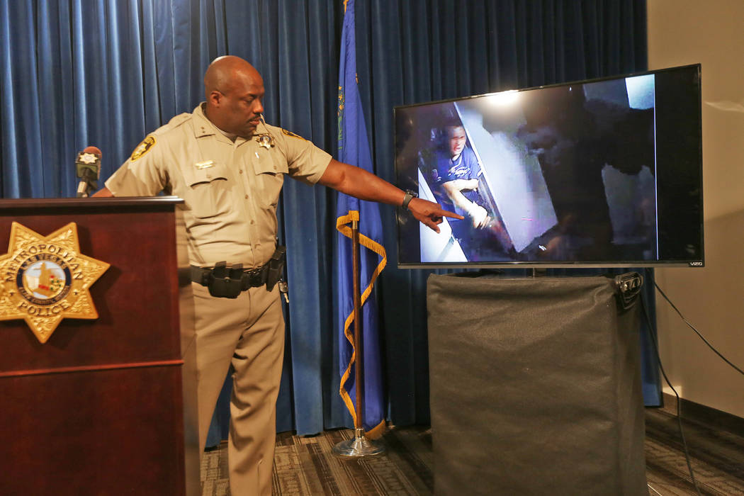 Assistant Sheriff Tim Kelly shows the press body camera footage from an officer involved shooting, pointing out the knife the suspect had in his hand, on Thursday, June 22, 2017, at Metropolitan P ...