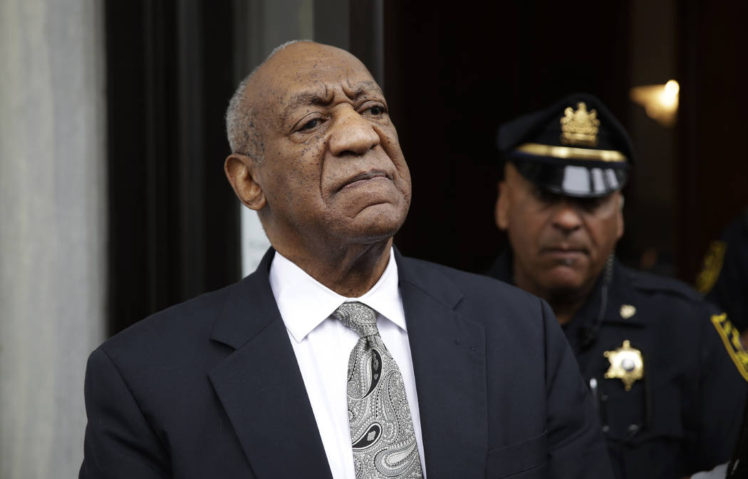 FILE - In this Saturday, June 17, 2017, file photo, Bill Cosby exits the Montgomery County Courthouse after a mistrial was declared in his sexual assault trial in Norristown, Pa. Judge Steven O'Ne ...
