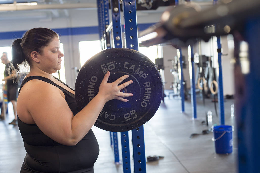 Kirsten Harris puts weights on a barbell during a workout at Camp Rhino's northwest location on Tuesday, June 13, 2017, in Las Vegas. Bridget Bennett Las Vegas Review-Journal @bridgetkbennett