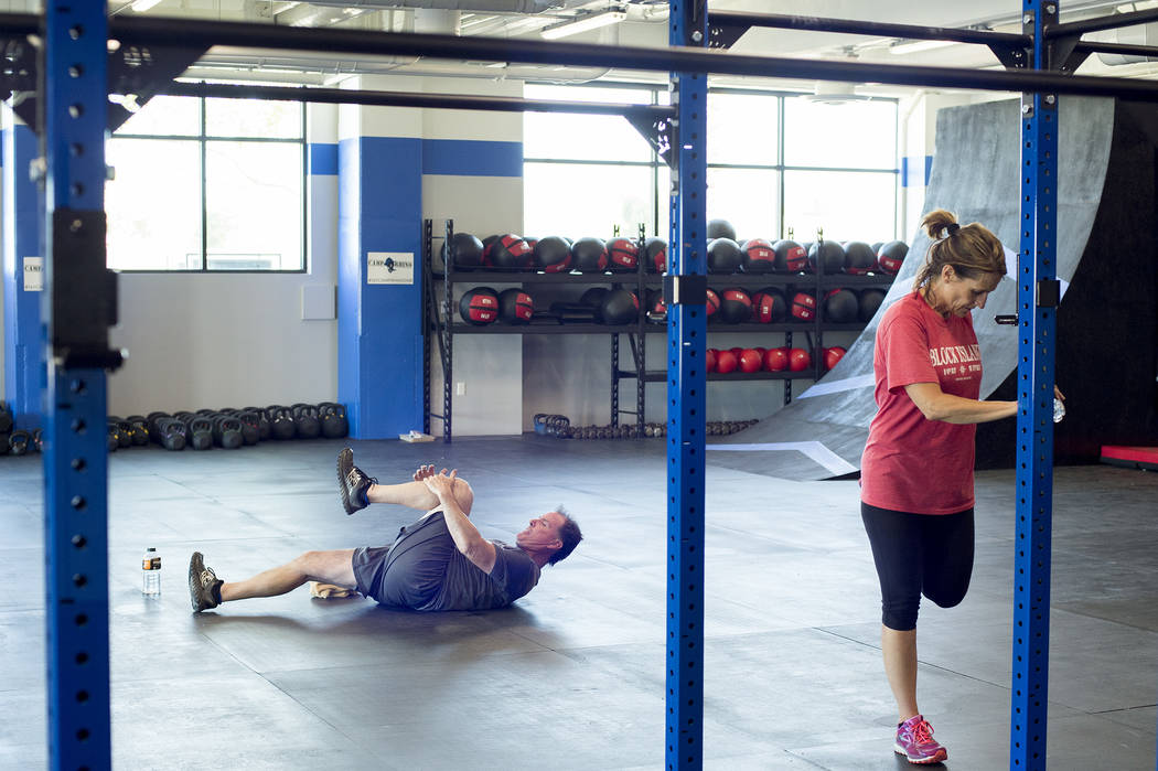 David Smith and wife Cheryl Smith stretch after a workout at Camp Rhino's northwest location on Tuesday, June 13, 2017, in Las Vegas. Bridget Bennett Las Vegas Review-Journal @bridgetkbennett