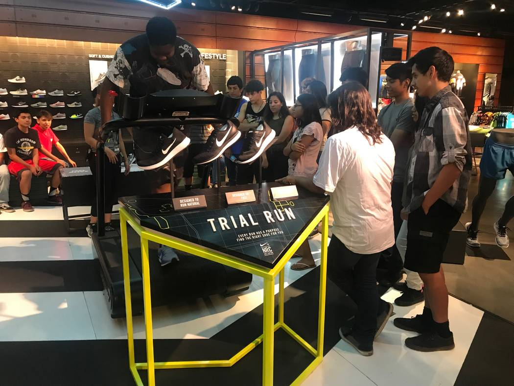 A student tries on shoes June 21 during presentation at Nike at the Caesars Forums Shops. (Kailyn Brown/View) @KailynHype