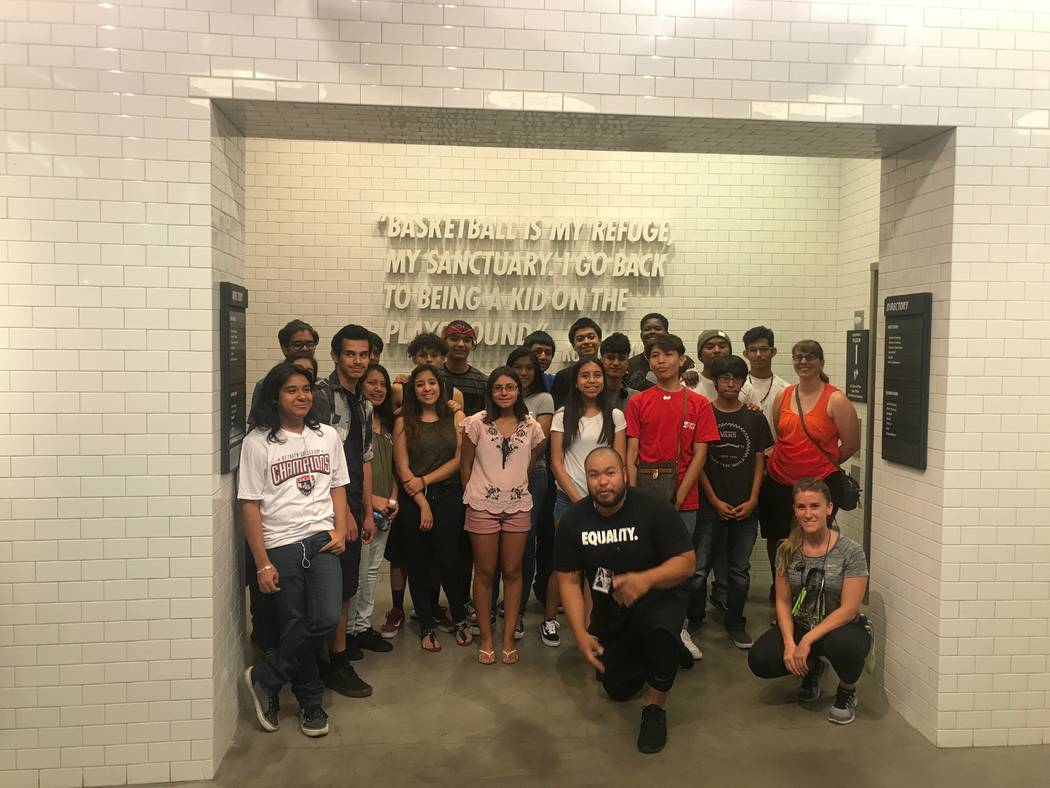 Core Academy Scholars, who are involved in UNLV's Young Executive Scholars Program, pose with guest speakers after presentation June 21 at Nike at the Caesars Forums Shops. (Kailyn Brown/View) @Ka ...