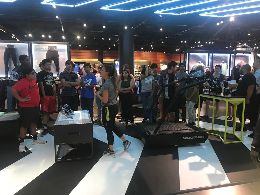 Core Academy Scholars, who are involved in UNLV's Young Executive Scholars Program, listen to guest speakers after presentation June 21 at Nike at the Caesars Forums Shops. (Kailyn Brown/View) @Ka ...