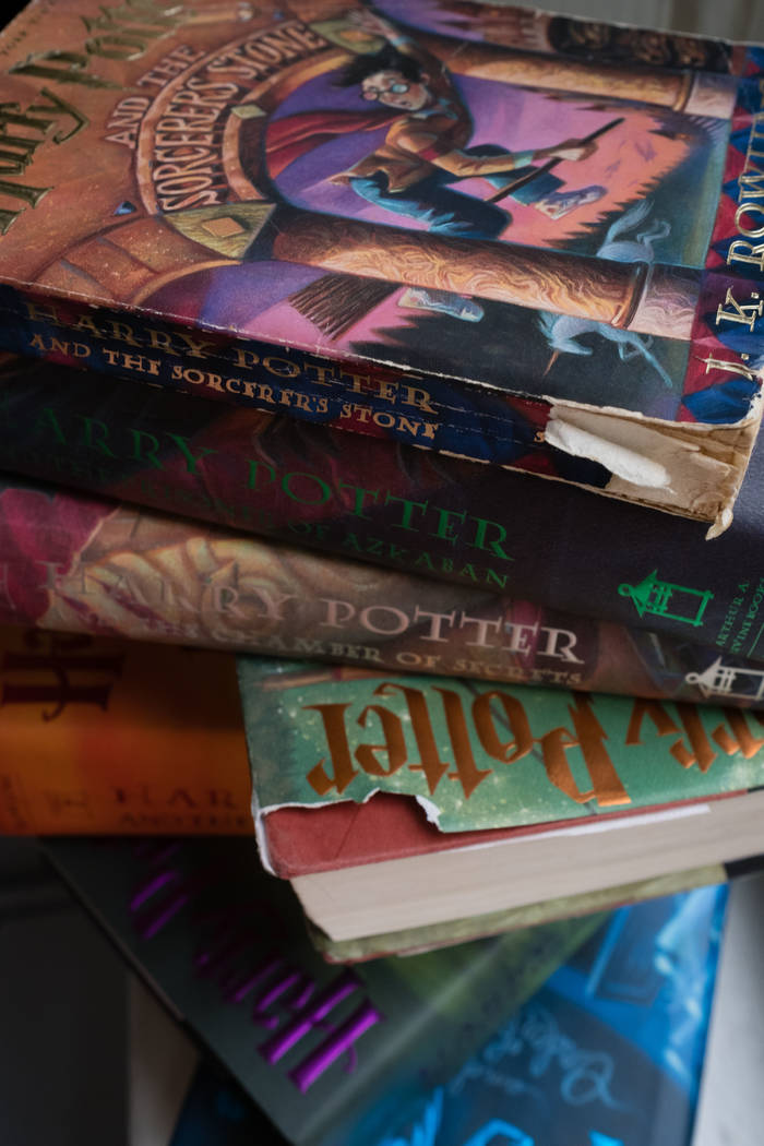The well-worn spines of the Harry Potter series. (Sarah L. Voisin/The Washington Post)