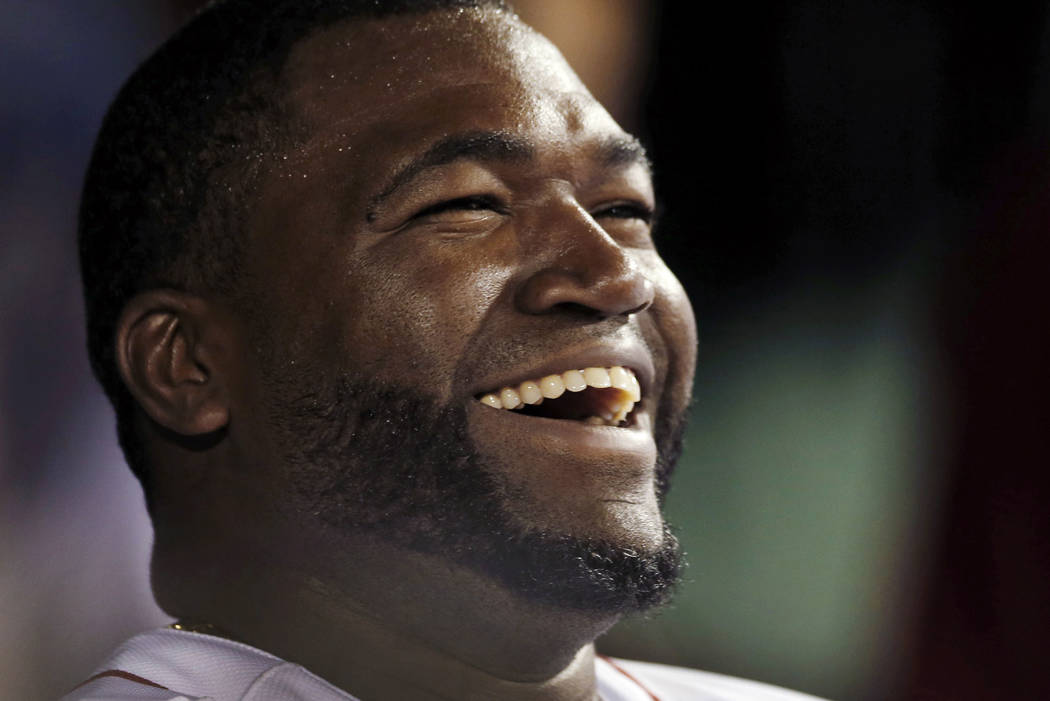 Boston Red Sox designated hitter David Ortiz laughs with teammates in the dugout after hitting a double for his 2,000th career hit, in the sixth inning of a baseball game against the Detroit Tiger ...