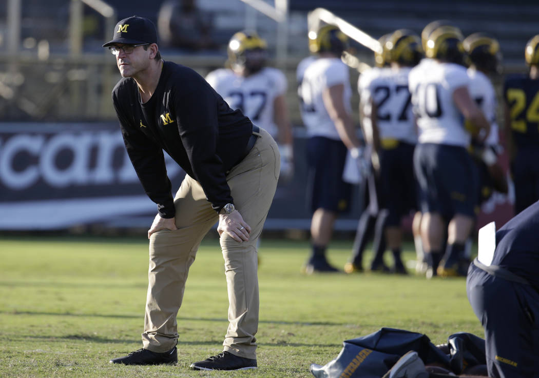 Michigan head coach Jim Harbaugh watches during NCAA college football practice, Tuesday, Dec. 27, 2016, in Miami. Michigan plays Florida State in the Orange Bowl Friday. (AP Photo/Lynne Sladky)