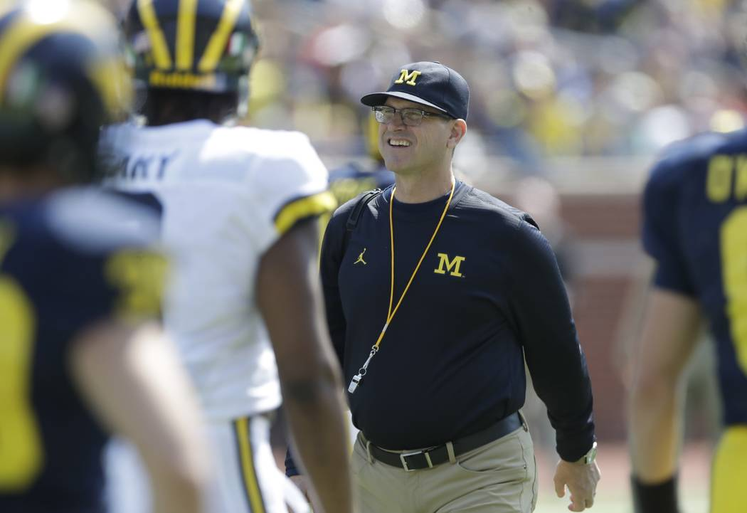Michigan head coach Jim Harbaugh is seen during the Michigan spring football game, Saturday, April 15, 2017, in Ann Arbor, Mich. (AP Photo/Carlos Osorio)