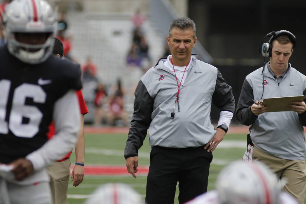 Ohio State head coach Urban Meyer watches their NCAA college spring football game Saturday, April 15, 2017, in Columbus, Ohio. (AP Photo/Jay LaPrete)