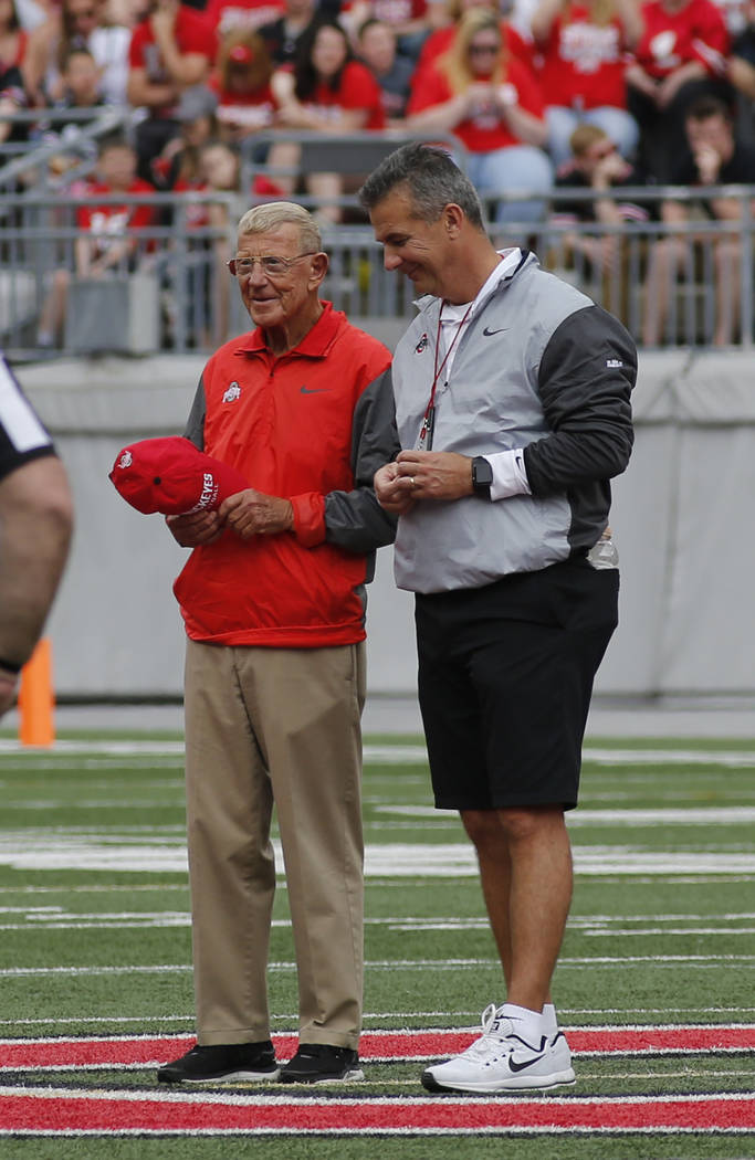 Ohio State head coach Urban Meyer, right, stands with Lou Holtz, former college football coach, as Holtz is recognized as the honorary captain of the Scarlet team during Ohio State's NCAA college  ...