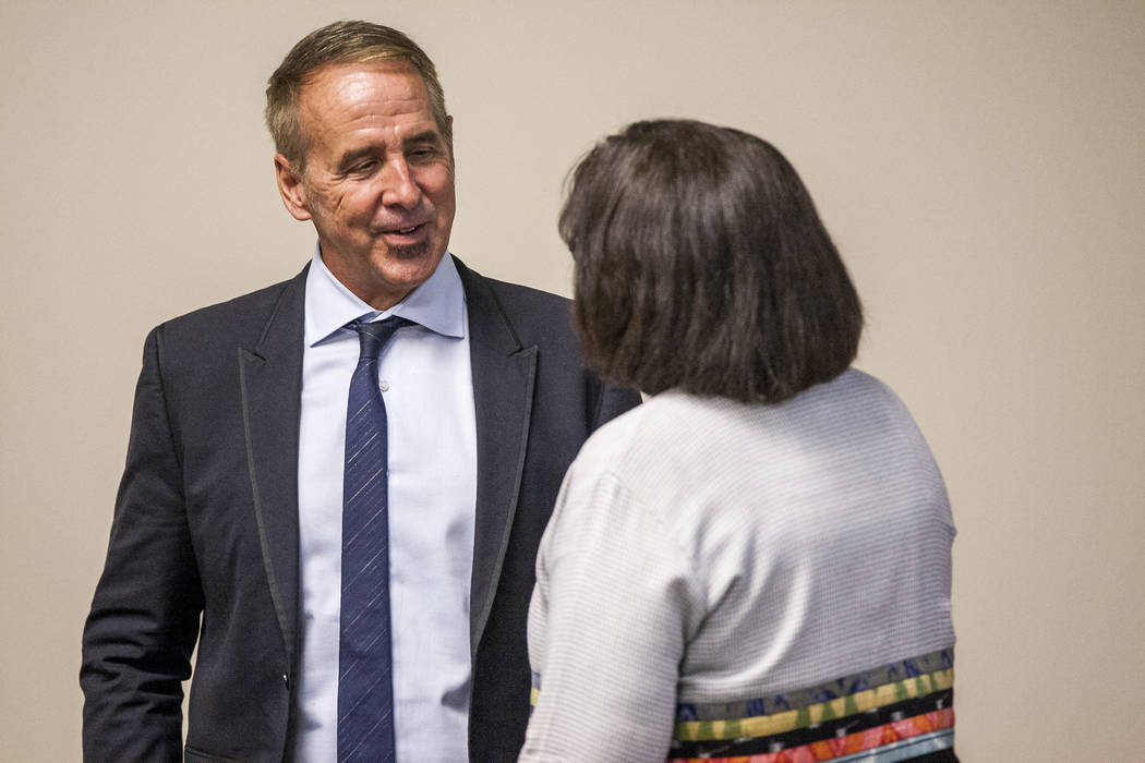 Thom Reilly, the newly appointed chancellor of the Nevada System of Higher Education, talks with Regent Cathy McAdoo after the Board of Regents meeting in the NSHE office in Las Vegas on Monday, J ...