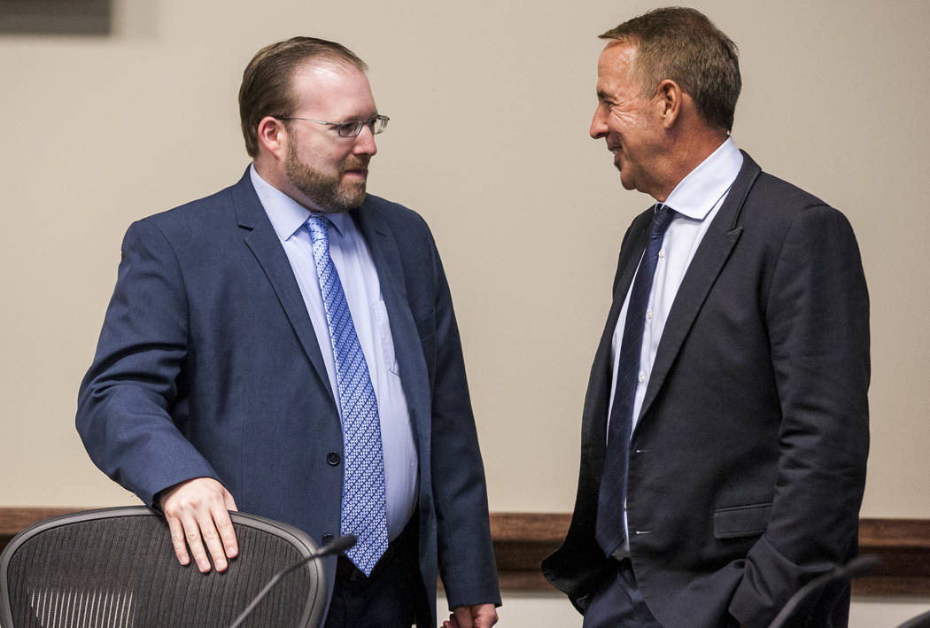 Thom Reilly, the newly appointed chancellor of the Nevada System of Higher Education, right, talks with Regent Patrick R. Carter after a Board of Regents meeting in the NSHE office in Las Vegas on ...