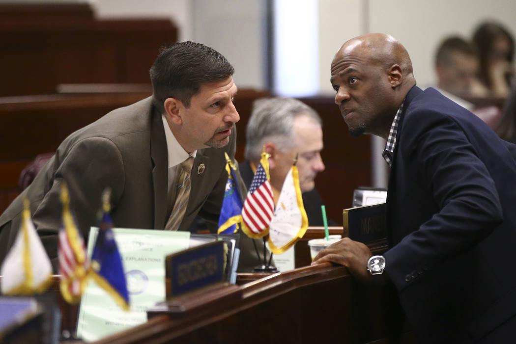 Sen. Mark Manendo, D-Las Vegas, left, talks with Sen. Kelvin Atkinson, D-North Las Vegas, during the second to last day of the Nevada Legislature at the Legislative Building in Carson City on Sund ...