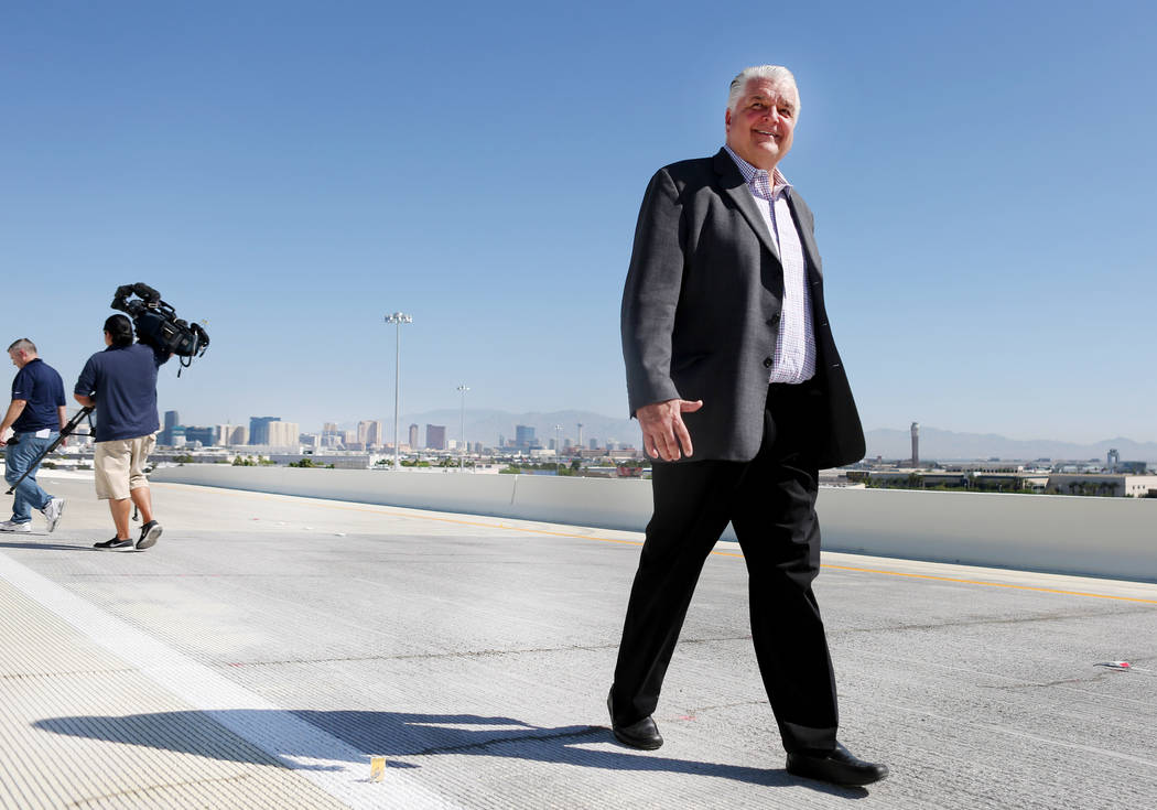 Clark County Commission Chairman Steve Sisolak walks on the new flyover ramp that links the southbound Airport Connector to the eastbound 215 Beltway near McCarran International Airport in Las Veg ...