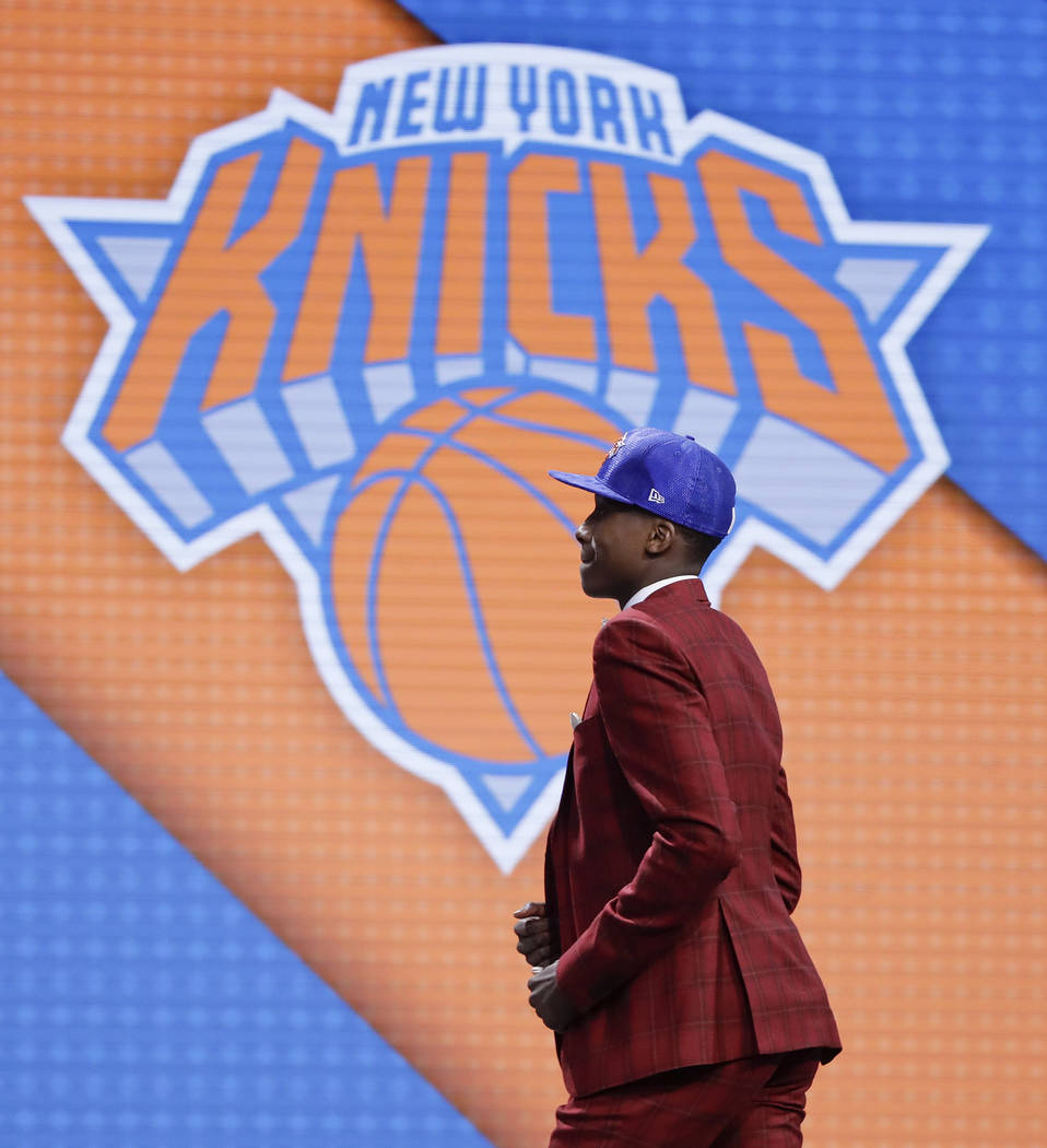 Frank Ntilikina walks up on stage after being selected by the New York Knicks as the eighth pick overall during the NBA basketball draft, Thursday, June 22, 2017, in New York. (AP Photo/Frank Fran ...