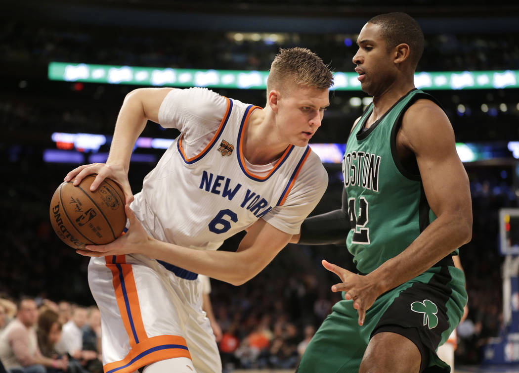 New York Knicks' Kristaps Porzingis, left, moves against Boston Celtics' Al Horford during the first half of the NBA basketball game, Sunday, April 2, 2017, in New York. (AP Photo/Seth Wenig)