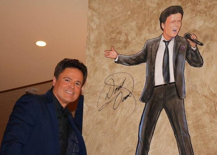 Donny Osmond is shown with a caricature of ... Donny Osmond, at The Palm Restaurant at Forum Shops at Caesars on Wednesday, June 21, 2017. (The Palm Restaurant)