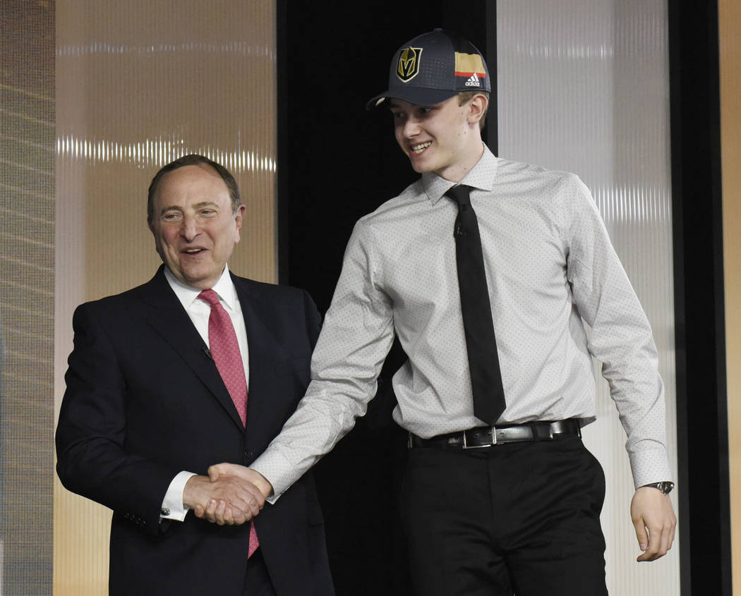 June 23, 2017; Chicago, IL, USA; Cody Glass is greets NHL commissioner Gary Bettman after being selected as the number six overall pick to the Vegas Golden Knights in the first round of the 2017 N ...