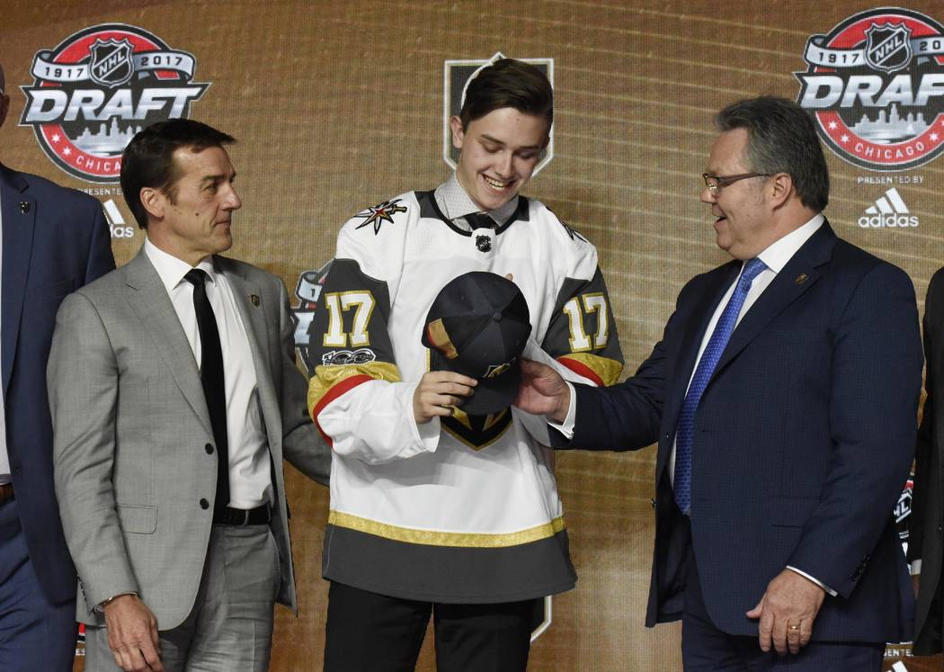 June 23, 2017; Chicago, IL, USA; Cody Glass gets a team hat after being selected as the number six overall pick to the Vegas Golden Knights in the first round of the 2017 NHL Draft at the United C ...
