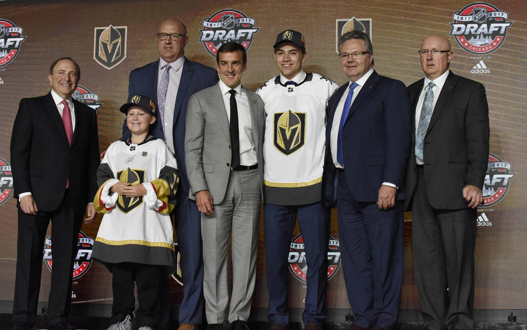 June 23, 2017; Chicago, IL, USA; Nick Suzuki poses for photos after being selected as the number thirteen overall pick to the Vegas Golden Knights in the first round of the 2017 NHL Draft at the U ...