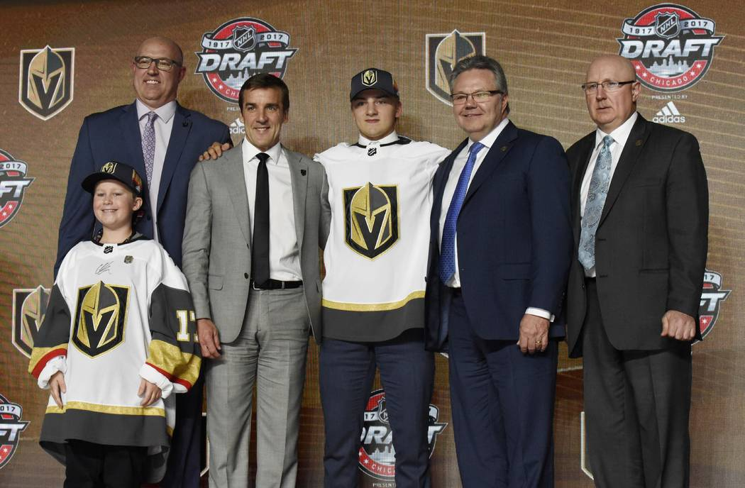 June 23, 2017; Chicago, IL, USA; Erik Brannstrom poses for photos after being selected as the number fifteen overall pick to the Vegas Golden Knights in the first round of the 2017 NHL Draft at th ...