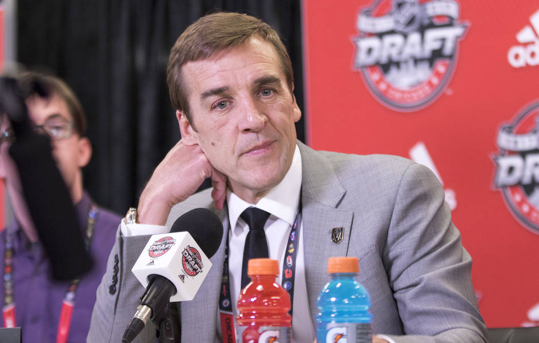 Vegas Golden Knights general manager George McPhee listens to questions at a media scrum following the first round of the 2017 NHL Entry Draft at the United Center in Chicago on Friday, June 23, 2 ...