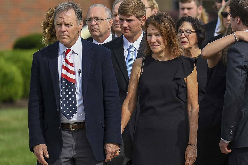 Fred and Cindy Warmbier watch as their son Otto, is placed in a hearse after his funeral, Thursday, June 22, 2017, in Wyoming, Ohio. Otto Warmbier, a 22-year-old University of Virginia undergradua ...
