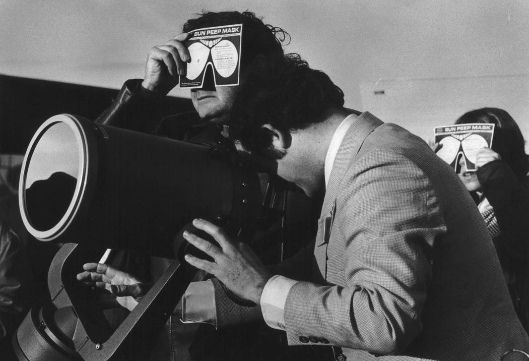 On Feb. 26, 1979, the path of a solar eclipse passes over Goldendale, Wash., as William Yantis, director of Golendale Observatory, peers into a Celestron telescope. The first place to experience t ...