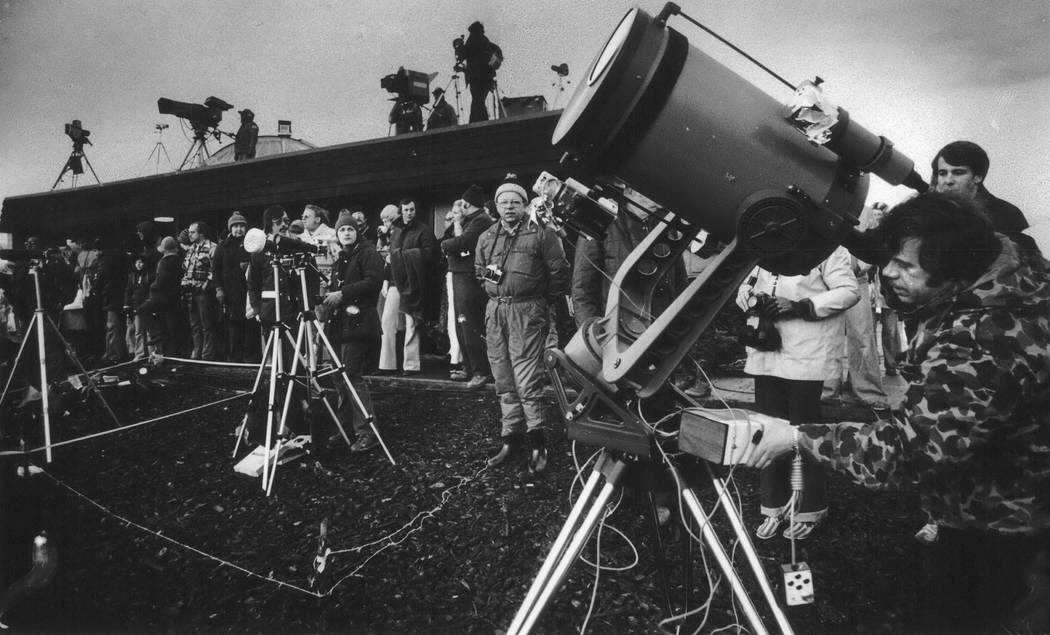 On Feb. 26, 1979, eclipse enthusiasts, photographers and television crews gather to watch the solar eclipse in Goldendale, Wash. The first place to experience total darkness as the moon passes bet ...