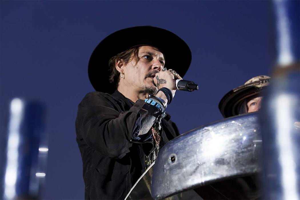 Actor Johnny Depp introduces a film at the Glastonbury music festival at Worthy Farm, in Somerset, England, Thursday, June 22, 2017. (Grant Pollard/Invision/AP)