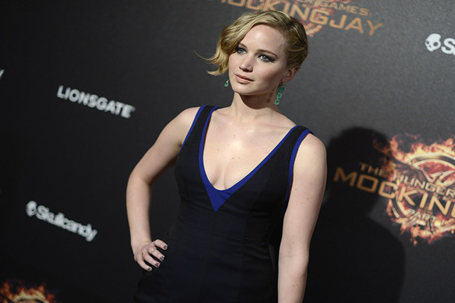 "Jennifer Lawrence appears at the ""Hunger Games: Mockingjay - Part 1"" party at the 67th international film festival, Cannes, southern France on May 17, 2014. (Arthur Mola/Invision/AP)"