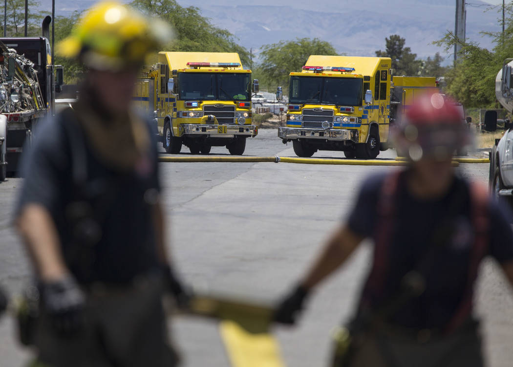 Firefighters work the scene of a two-alarm fire at a recycling plant located at 2570 Marco St., near Carey Avenue and Nellis Boulevard, on Friday, June 23, 2017. (Richard Brian/Las Vegas Review-Jo ...