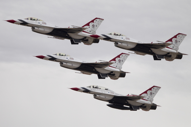 U.S. Air Force Thunderbirds take flight for a demonstration following a ribbon-cutting ceremony of the renovated U.S. Air Force Thunderbirds museum at Nellis Air Force Base, Friday, Feb. 17, 2017, ...