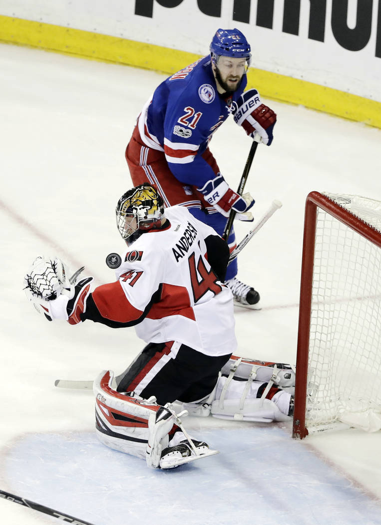 Ottawa Senators goalie Craig Anderson (41) stops a shot on the goal as New York Rangers' Derek Stepan (21) skates past him during the third period of Game 6 of an NHL hockey Stanley Cup second-rou ...