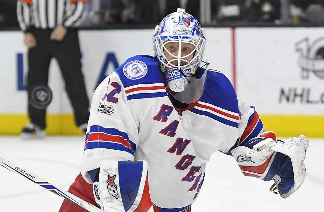 FILE - In this Saturday, March 25, 2017, file photo, New York Rangers goalie Antti Raanta, of Finland, deflects a shot during the second period of the team's NHL hockey game against the Los Angele ...