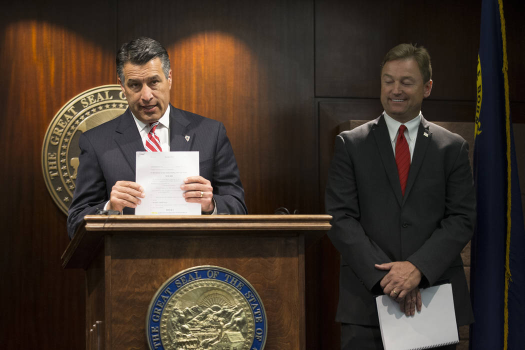 Nevada Gov. Brian Sandoval, left, and Sen. Dean Heller during a press conference where the senator announced he will vote no on the proposed GOP healthcare bill at the Sawyer Building on Friday, J ...