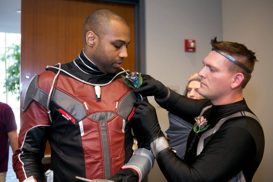 Groomsmen put on the finishing touches before the wedding of Megan Mattingly and Adam Merica at Awesome Con. (Linda Wang/The Washington Post)