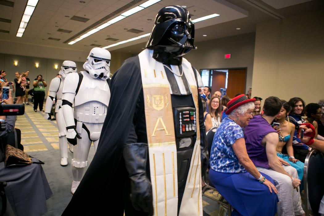 Darth Vader leads the wedding procession. (Linda Wang/The Washington Post)