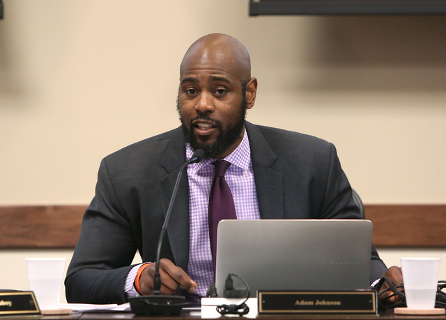 Adam Johnson, State Public Charter School Authority chair, announces the postponement of the public hearing on a charter school's possible closure at the Nevada System of Higher Education building ...