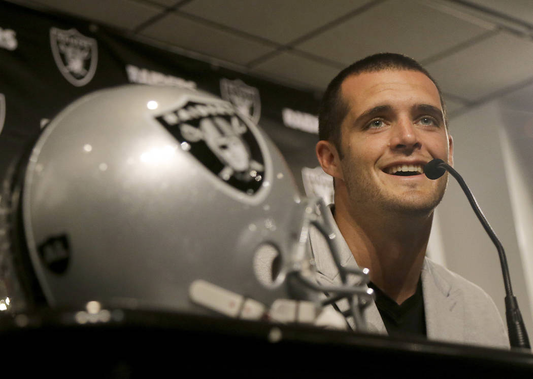Oakland Raiders quarterback Derek Carr smiles while speaking at a news conference in Oakland, Calif., Friday, June 23, 2017. Carr finalized a five-year contract extension that will keep him with t ...