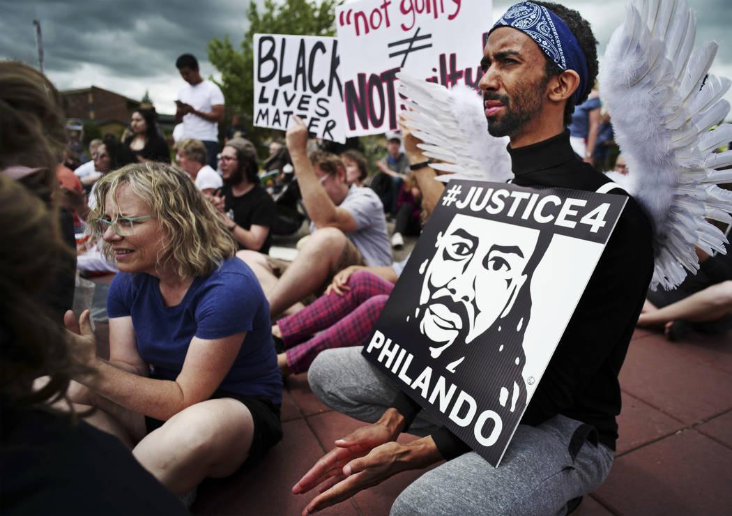 Richard Tsong-Taatarii/Star Tribune via AP