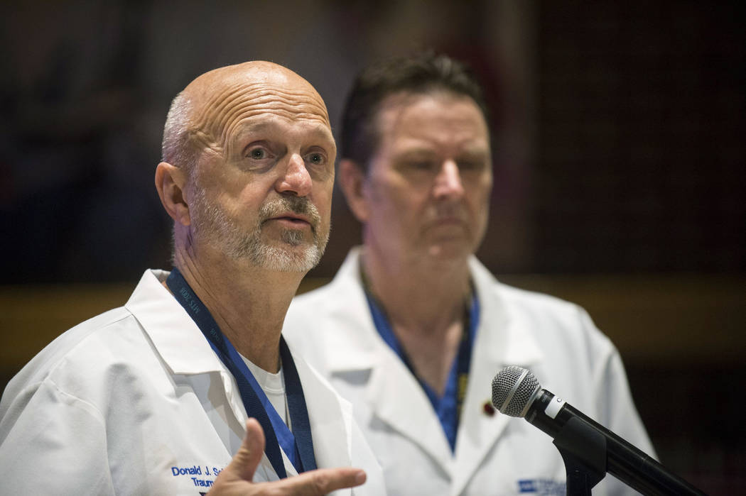 Hurley Trauma Surgeon, Dr. Donald Scholten, M.D. and Hurley Trauma and Surgical Critical Care Chief, Dr. Leo Mercer answer questions from the media during a press conference Friday June 23, 2017,  ...