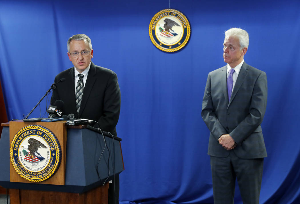 David P. Gelios, left, Special Agent in Charge, Detroit Division of the FBI, and Daniel L. Lemisch, Acting U.S. Attorney of the Eastern District of Michigan, speak during a news conference in Detr ...