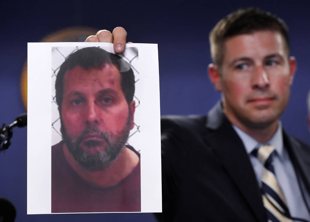Timothy Wiley, FBI public affairs specialist, holds a photo Amor Ftouhi after a news conference in Detroit, Thursday, June 22, 2017. Amor Ftouhi, a Canadian man, shouted in Arabic before stabbing  ...
